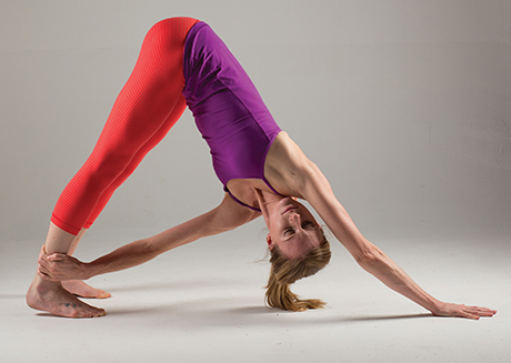 revolved downward facing dog  yoga magazine